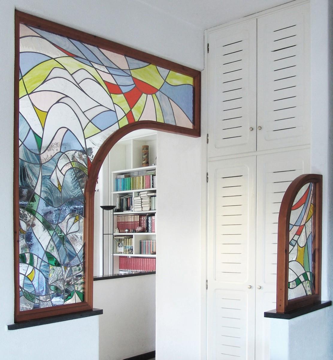 Pannelli collocati su muro tra ingresso-soggiorno e cucina | Mosaici ...